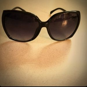 Chanel Sunglasses Black with Gold emblem.